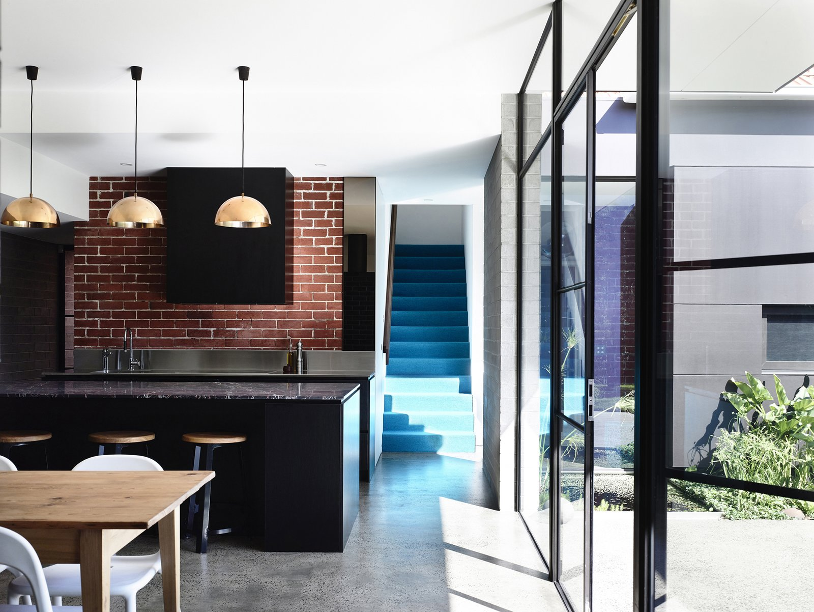 Kitchen, Concrete Floor, Brick Backsplashe, and Pendant Lighting  Photo 3 of 10 in Old Meets New in This Modern Extension to an Edwardian House in Melbourne