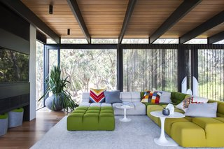 Unexpected Bursts of Color Enliven a Midcentury Pad in Australia