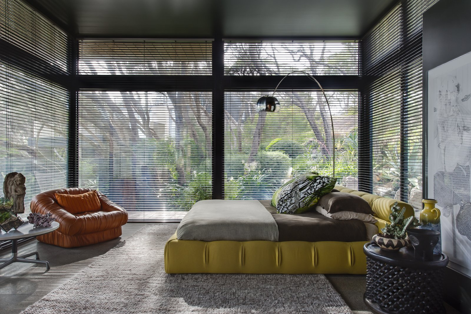 Bedroom, Chair, Bed, Floor Lighting, and Night Stands  Photo 4 of 7 in Unexpected Bursts of Color Enliven a Midcentury Pad in Australia
