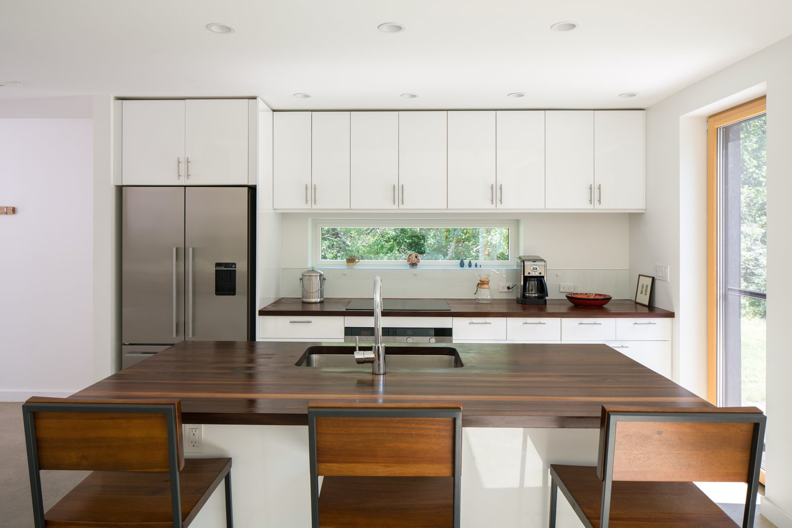 Kitchen, Wood Counter, Refrigerator, Recessed Lighting, Undermount Sink, and White Cabinet  Photo 8 of 10 in GO Home Takes the Passive House Approach to Prefab