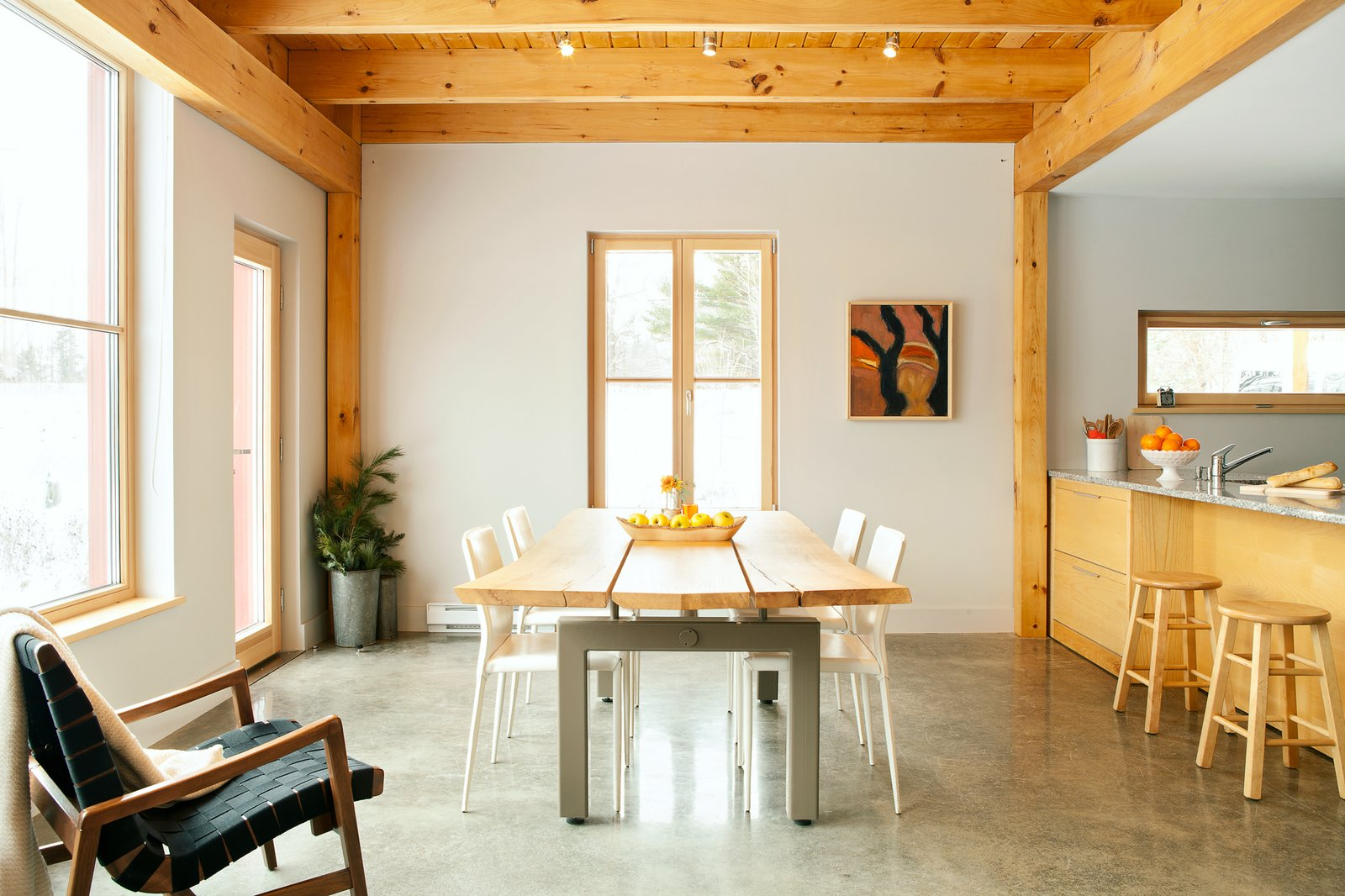 Dining Room, Track Lighting, Table, Concrete Floor, Stools, Bar, and Chair  Photo 7 of 10 in GO Home Takes the Passive House Approach to Prefab