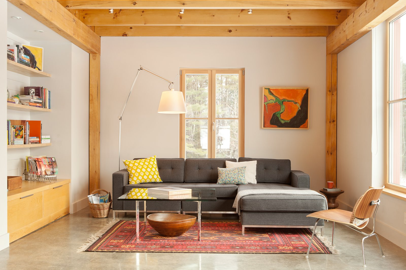 Living, Sectional, Coffee Tables, Chair, Shelves, Track, Concrete, Rug, Floor, Lamps, and End Tables  Best Living Track Floor Photos from GO Home Takes the Passive House Approach to Prefab