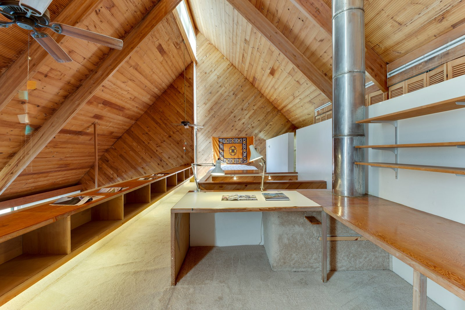 Office, Study Room Type, Lamps, Desk, and Storage  Photo 10 of 13 in A Renowned Florida Architect's Geometric Family Home Hits the Market For the First Time