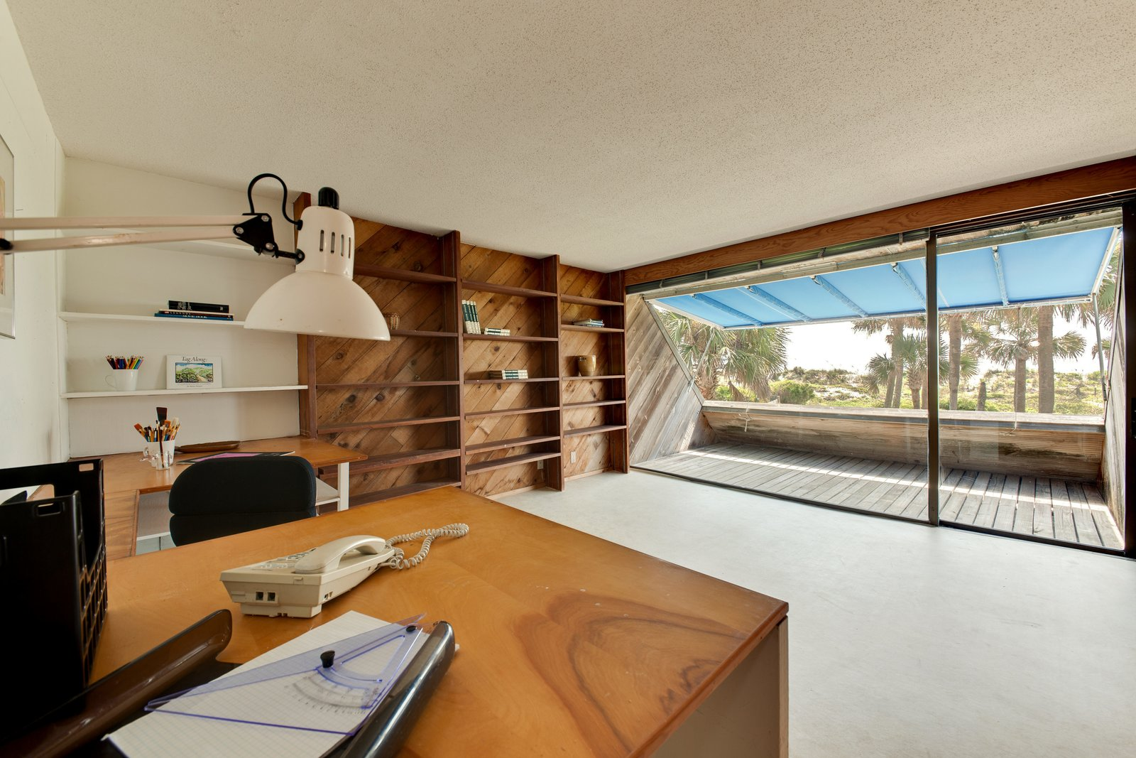 Office, Chair, Study Room Type, Desk, Shelves, and Lamps  Photo 11 of 13 in A Renowned Florida Architect's Geometric Family Home Hits the Market For the First Time