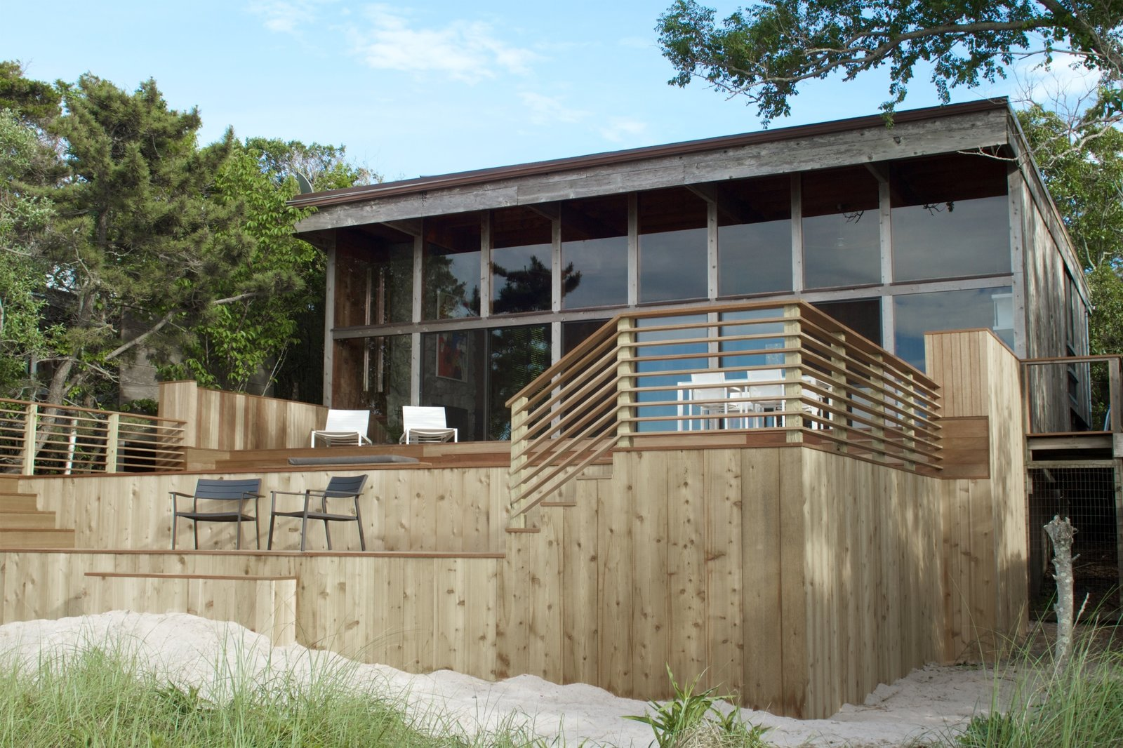Photo 1 of 10 in A Respectfully Renovated Modern Beach House on Fire Island Asks $1.8M