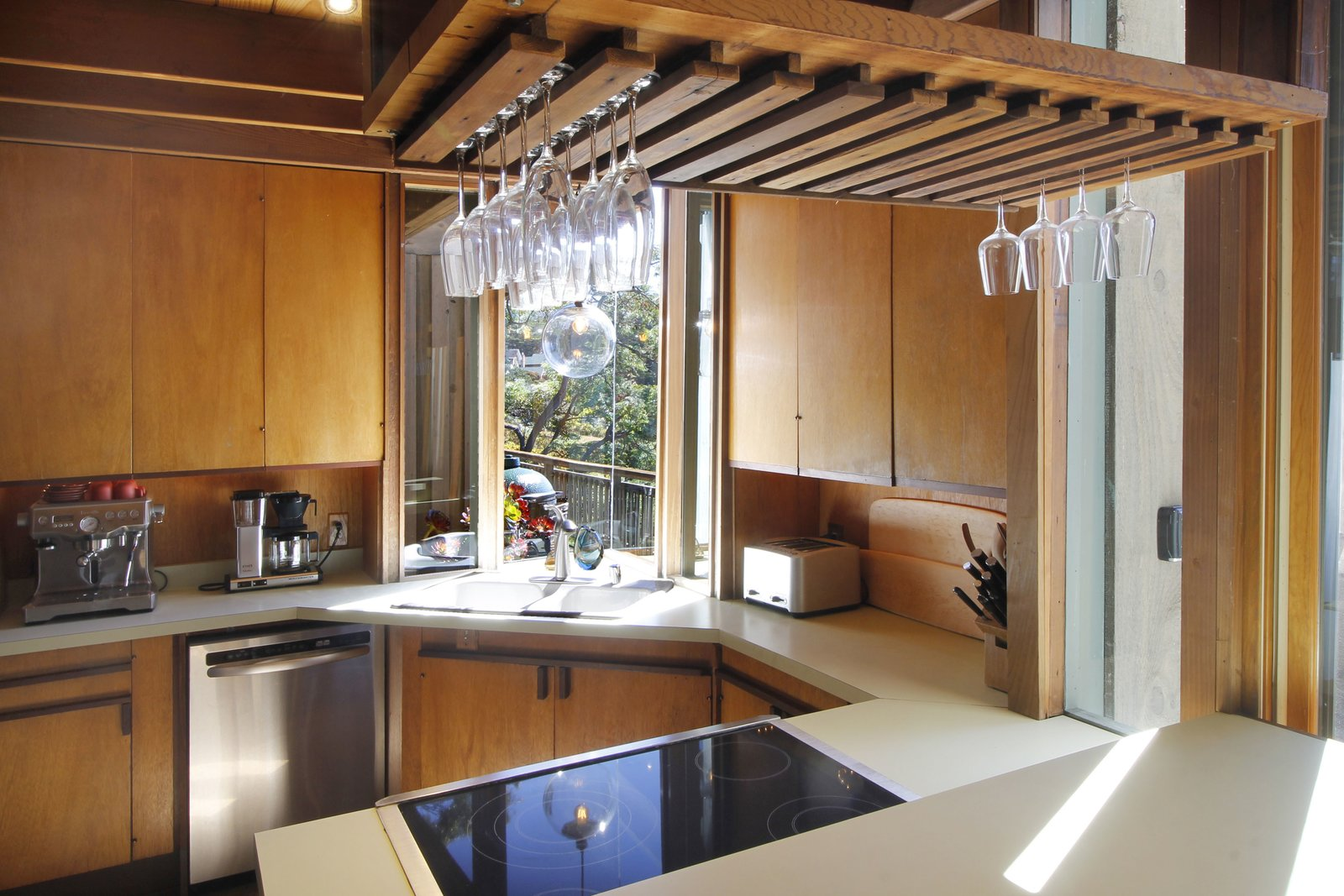 Kitchen, Wood Cabinet, Cooktops, Recessed Lighting, Dishwasher, Beverage Center, Wood Backsplashe, and Drop In Sink  Photo 5 of 11 in A Perfectly Preserved Midcentury Pad in Northern California Asks $1.975M
