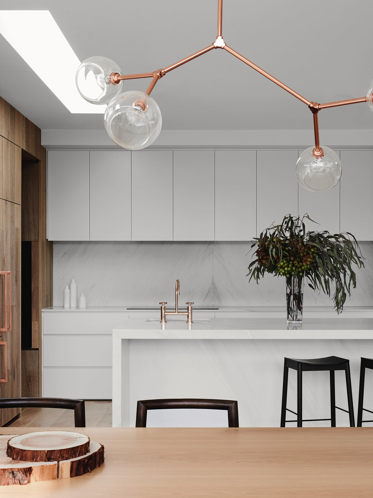 Marble, Range, White, Marble, Light Hardwood, Pendant, Drop In, Windows, and Skylight  Best Windows Drop In Skylight Photos from A Run-Down Melbourne Bungalow's Makeover Embraces Light and Family Life