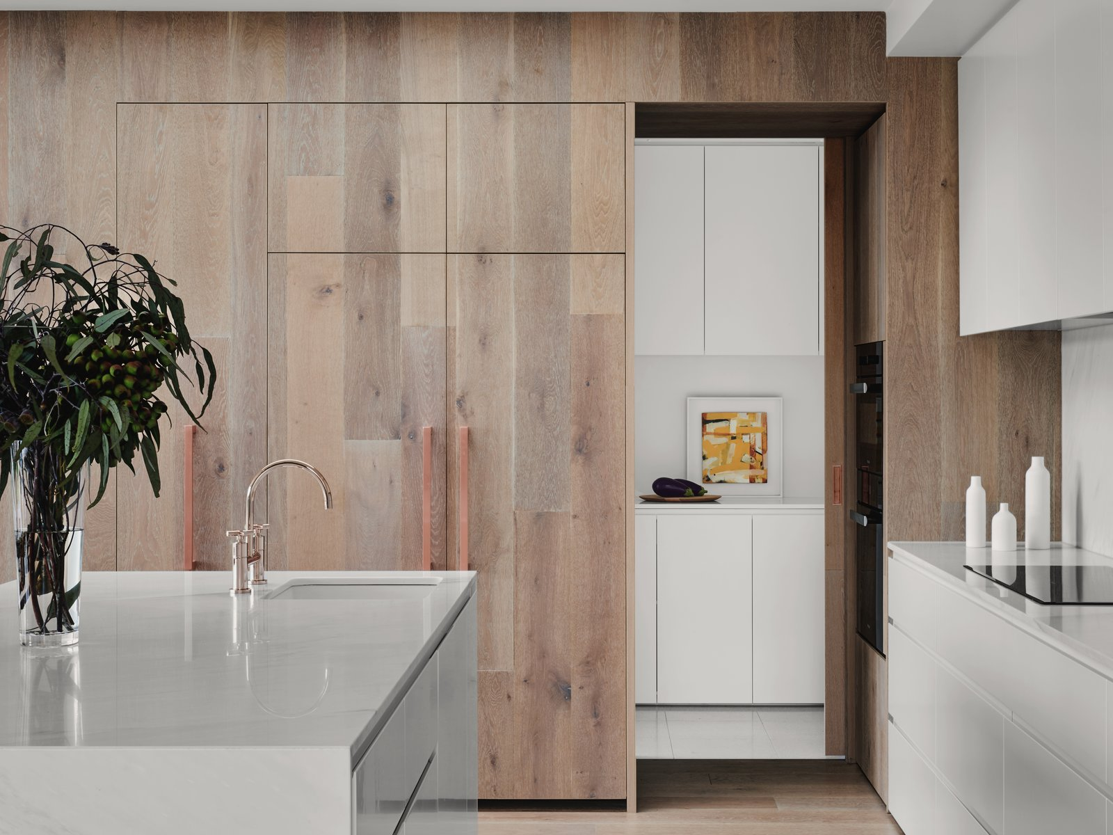 Kitchen, Wood, White, Marble, Wall Oven, Marble, Range, Drop In, and Light Hardwood  Best Kitchen Wall Oven Range Photos from A Run-Down Melbourne Bungalow's Makeover Embraces Light and Family Life