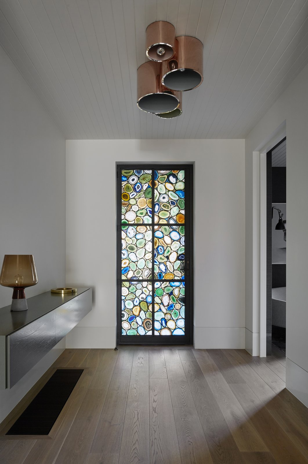 Casement Window Type, Metal, Hallway, and Medium Hardwood Floor  Photo 7 of 11 in See How Sliding-Glass Pavilions Transformed a Renovated Melbourne Home