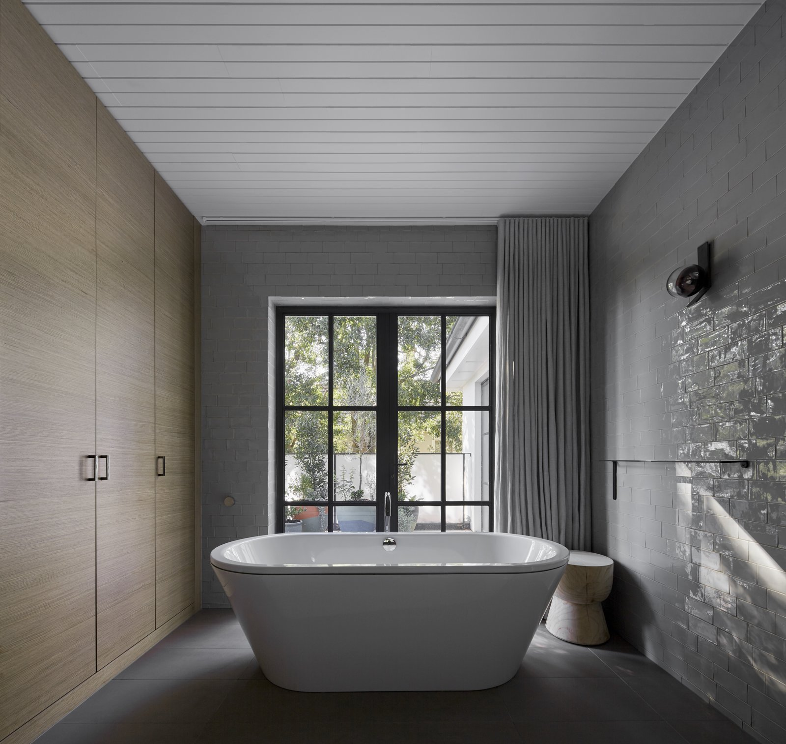 Bath Room, Freestanding Tub, and Wall Lighting  Photo 11 of 11 in See How Sliding-Glass Pavilions Transformed a Renovated Melbourne Home