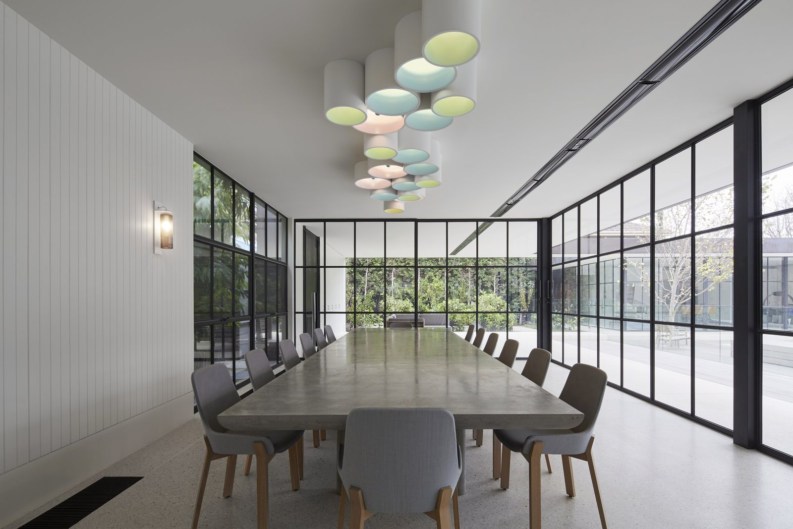 Dining Room, Chair, Table, Ceiling Lighting, and Wall Lighting  Photo 6 of 11 in See How Sliding-Glass Pavilions Transformed a Renovated Melbourne Home