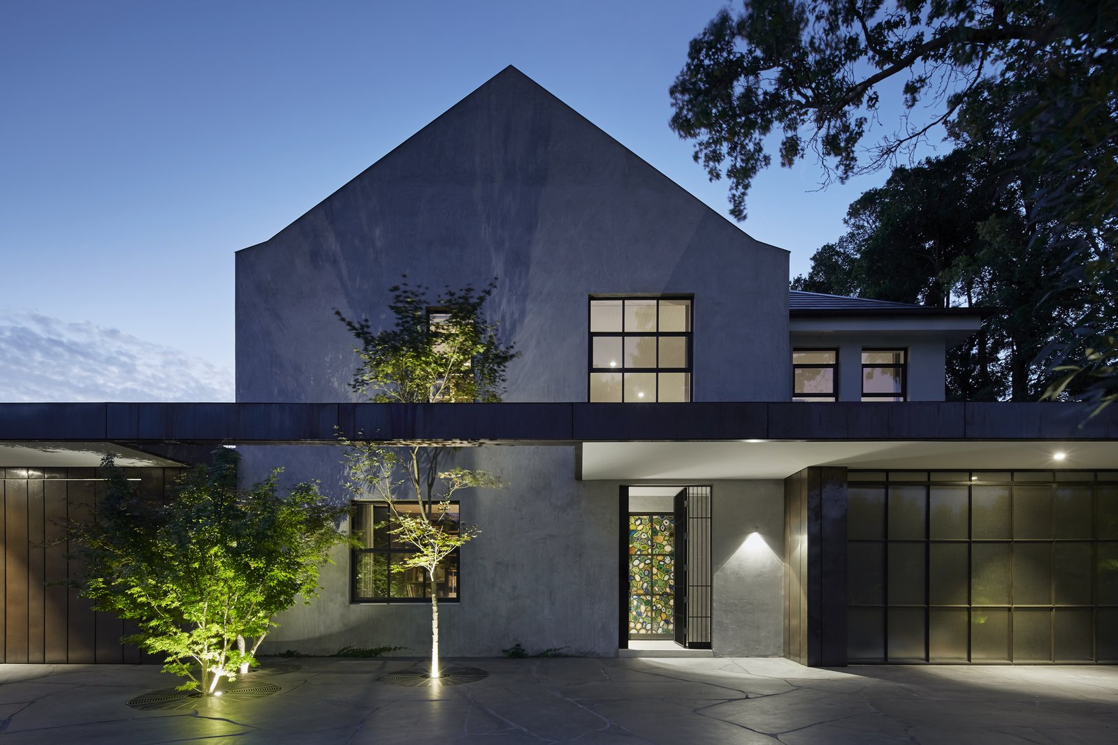 House Building Type, Concrete Siding Material, Outdoor, Front Yard, Trees, Landscape Lighting, and Walkways  Photo 2 of 11 in See How Sliding-Glass Pavilions Transformed a Renovated Melbourne Home