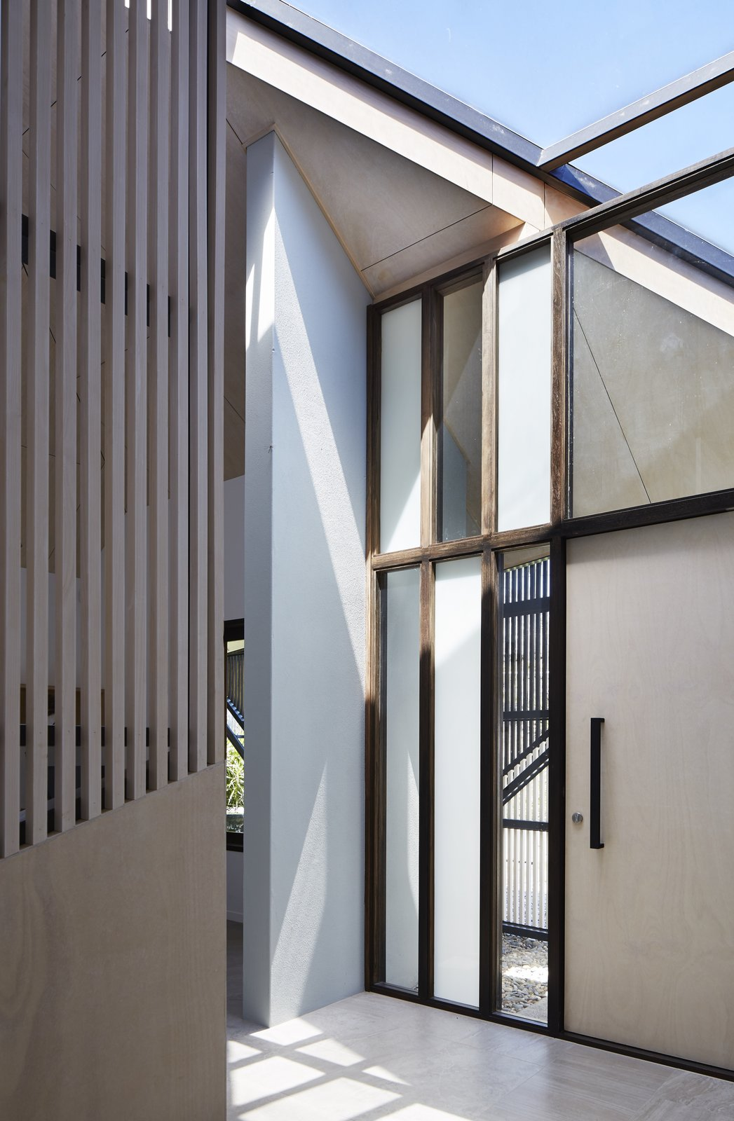 Hallway  Photo 3 of 12 in An Edgy Slatted Facade Conceals a Striking Indoor/Outdoor Home in Brisbane