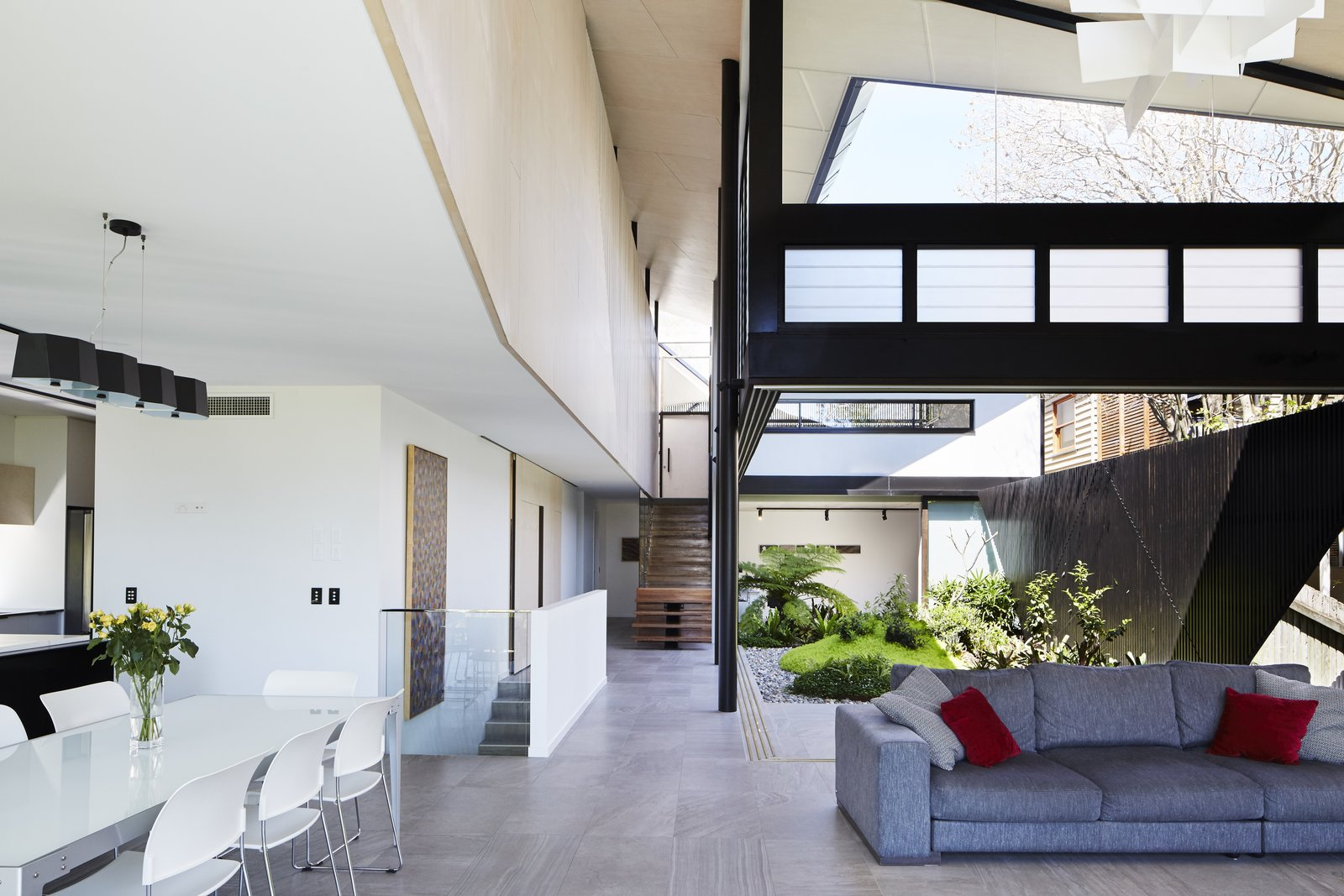 Living Room, Sofa, Chair, Table, and Pendant Lighting  Photo 12 of 12 in An Edgy Slatted Facade Conceals a Striking Indoor/Outdoor Home in Brisbane