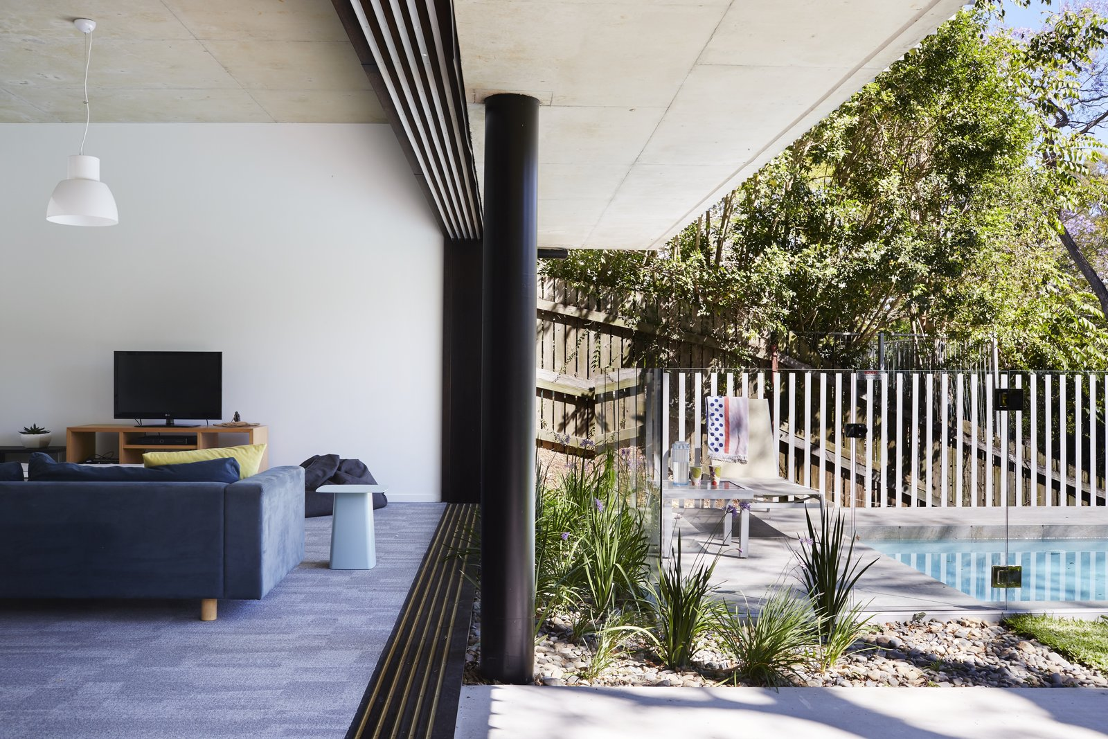 Outdoor, Back Yard, Trees, Shrubs, Hardscapes, Small Pools, Tubs, Shower, Large Patio, Porch, Deck, and Vertical Fences, Wall  Photo 10 of 12 in An Edgy Slatted Facade Conceals a Striking Indoor/Outdoor Home in Brisbane