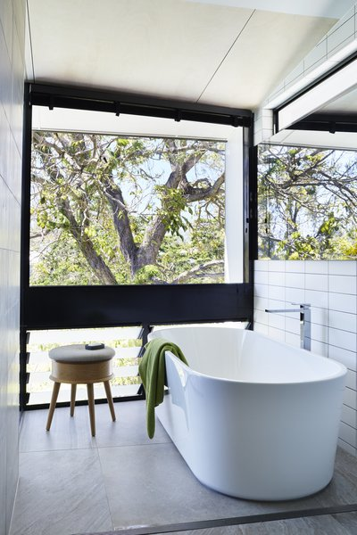 Bath Room, Freestanding Tub, Soaking Tub, and Subway Tile Wall  Photo 6 of 12 in An Edgy Slatted Facade Conceals a Striking Indoor/Outdoor Home in Brisbane