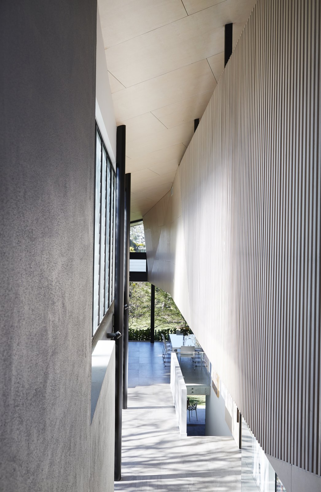 Hallway  Photo 9 of 12 in An Edgy Slatted Facade Conceals a Striking Indoor/Outdoor Home in Brisbane