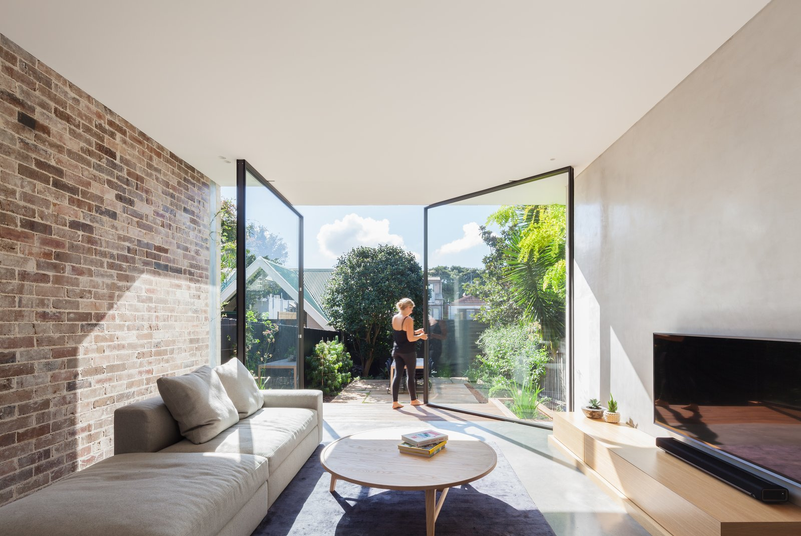 Metal, Living, Sofa, Coffee Tables, Recessed, Concrete, Rug, and Media Cabinet  Best Living Recessed Media Cabinet Photos from A Streamlined Addition Revives a Gloomy Victorian in Sydney