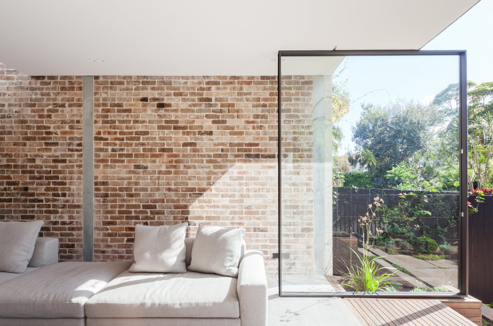 Metal, Picture Window Type, Living Room, Sofa, Recessed Lighting, and Concrete Floor  Photos from A Streamlined Addition Revives a Gloomy Victorian in Sydney