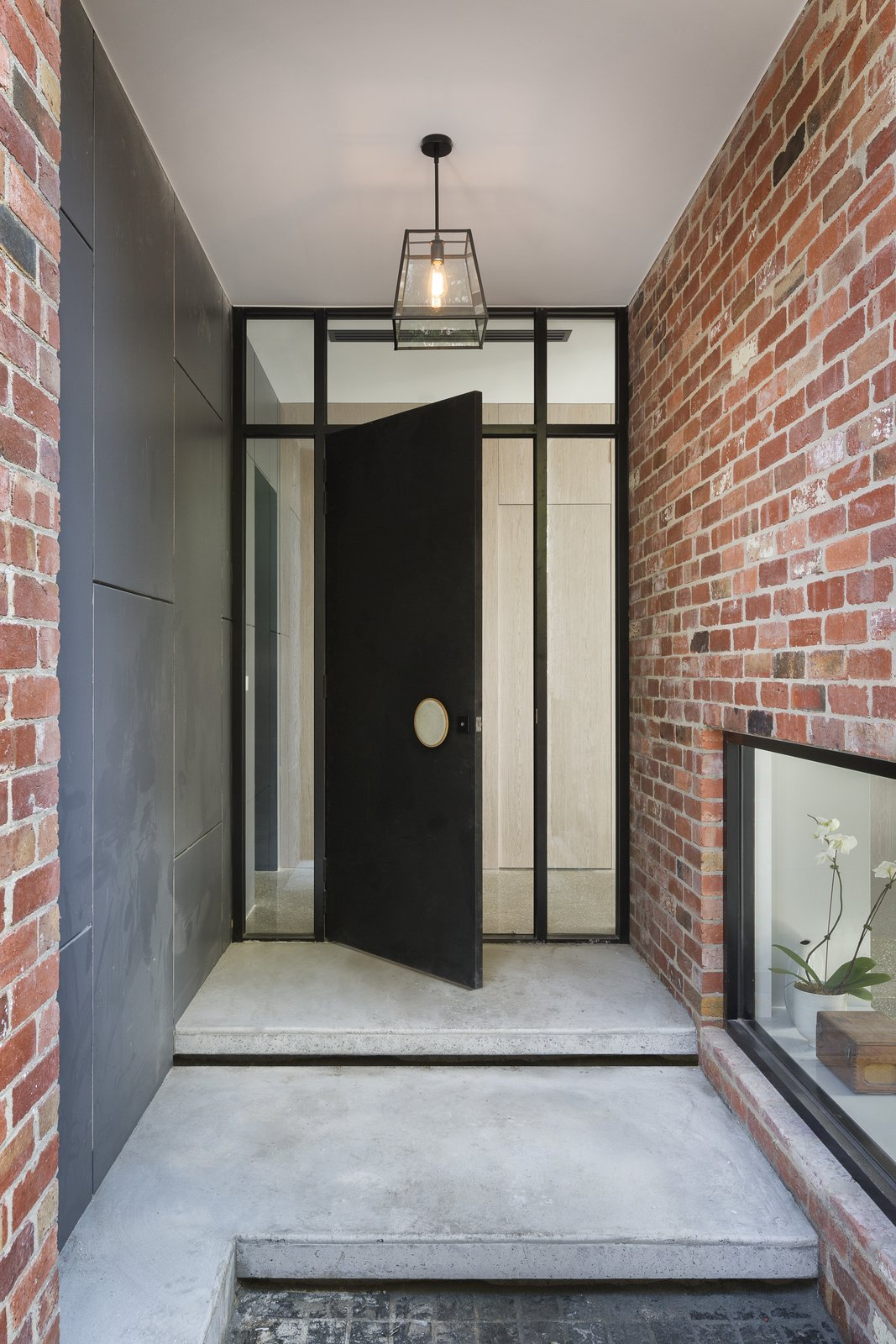 Doors, Exterior, Metal, and Swing Door Type  Best Photos from A Progressive Melbourne Development Company Helps Facilitate an Exquisite Home Renovation