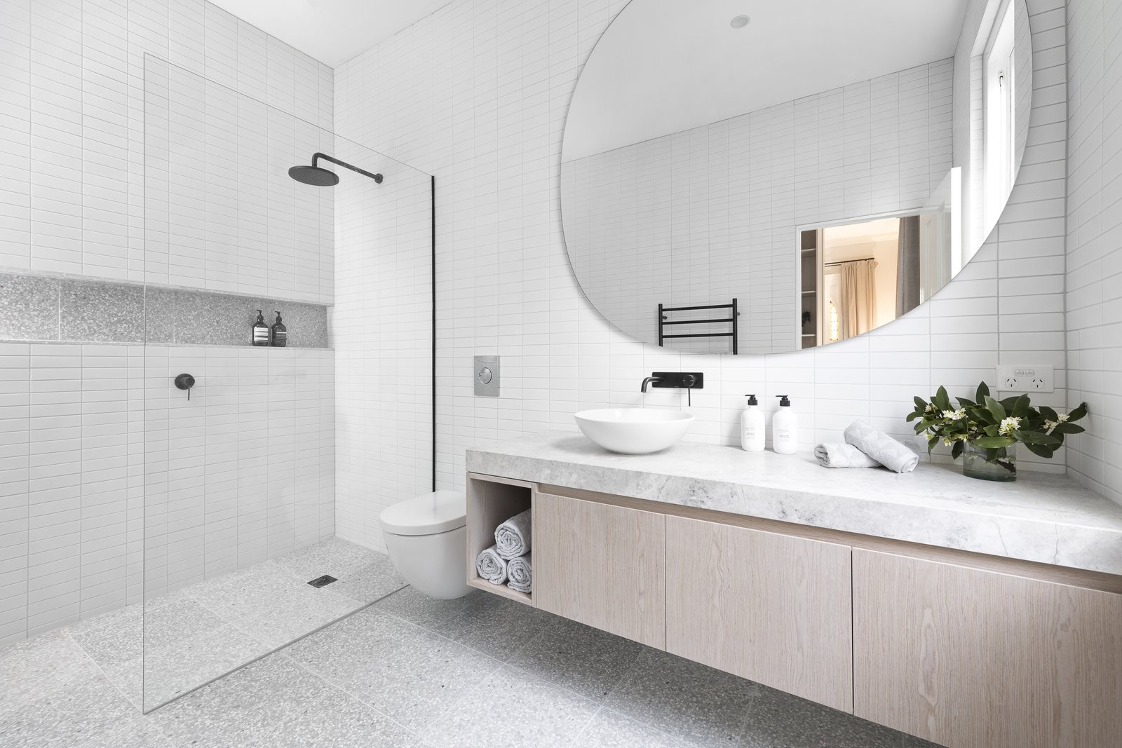 Bath Room, Marble Counter, Enclosed Shower, and Full Shower  Photo 8 of 12 in A Progressive Melbourne Development Company Helps Facilitate an Exquisite Home Renovation