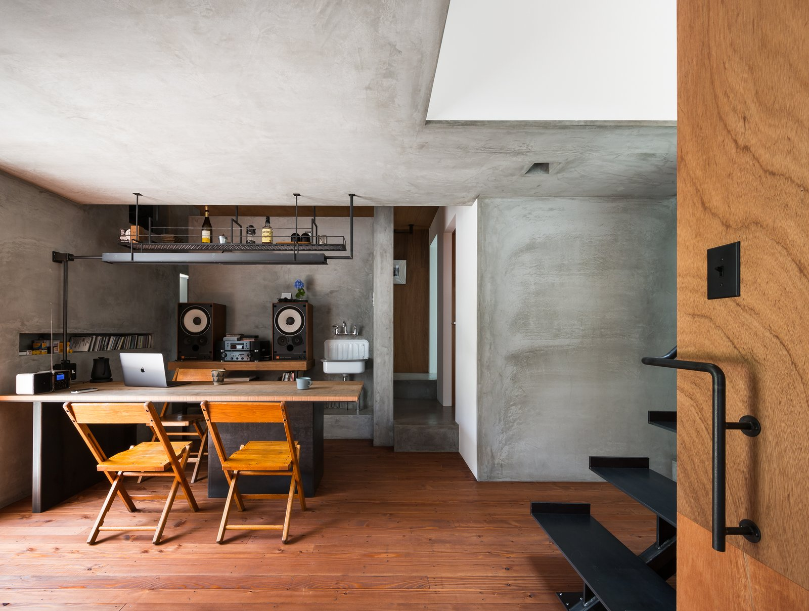 Office, Study, Chair, Storage, Desk, and Medium Hardwood  Best Office Medium Hardwood Storage Photos from Find Out How a Japanese Architect Created a Fluid Live/Work Space For a Photographer