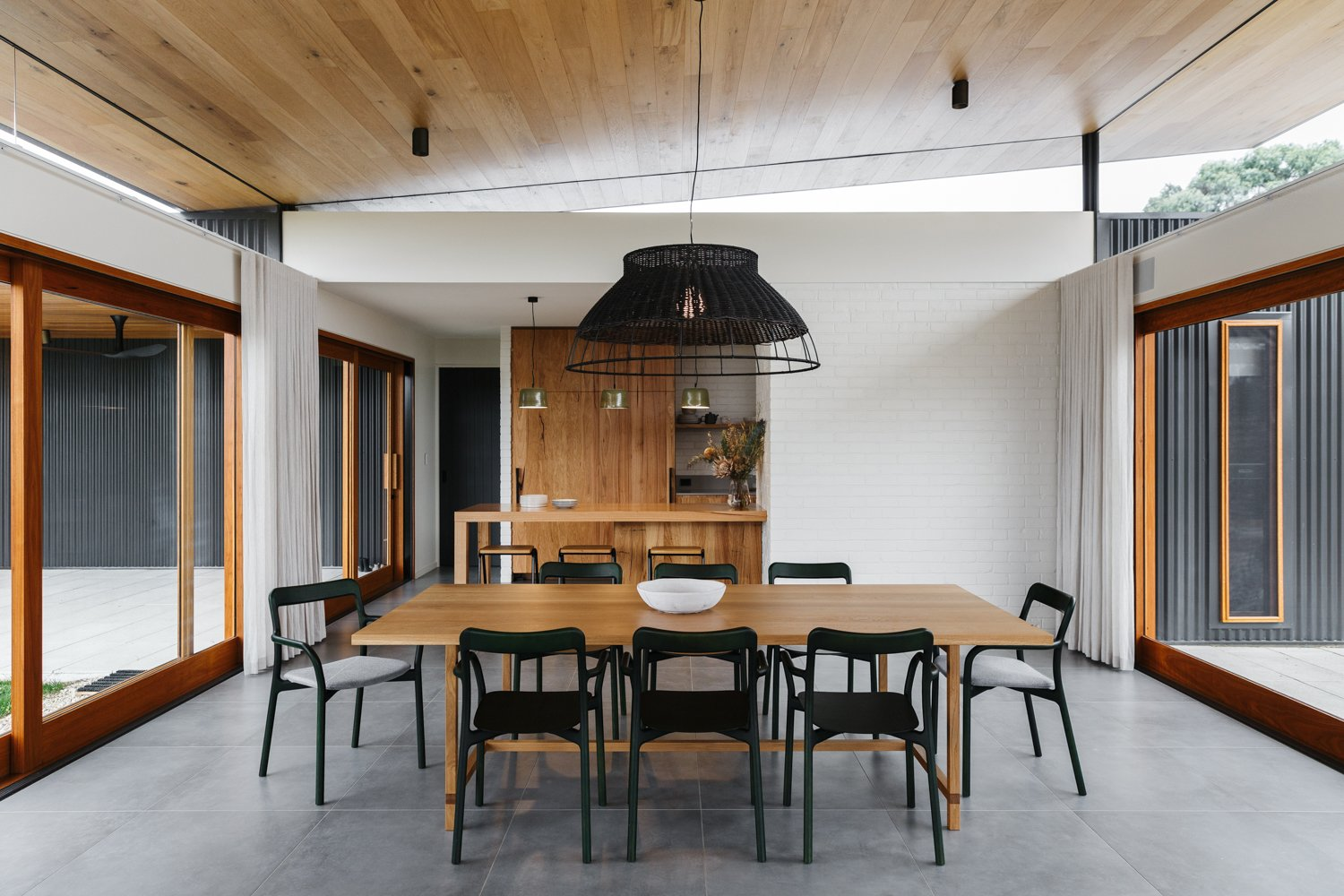 Dining Room, Chair, Table, and Pendant Lighting  Photo 1 of 11 in The Surrounding Countryside Inspires a Family Home in Australia's Adelaide Hills