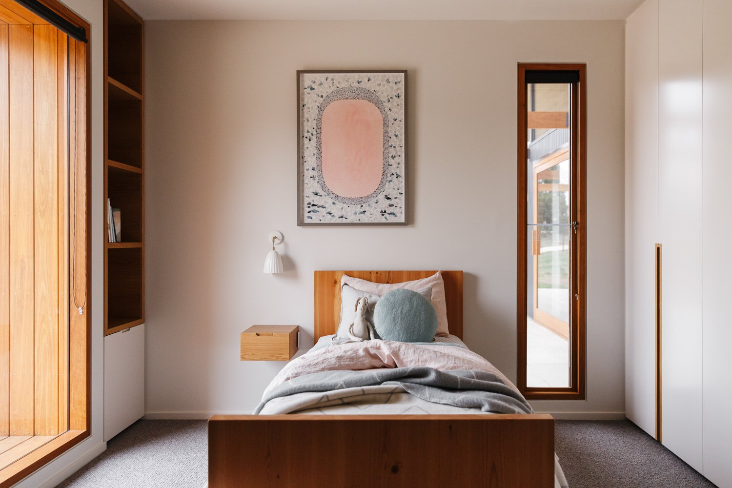 Kids Room, Bedroom Room Type, Bed, Storage, Carpet Floor, and Girl Gender  Photo 11 of 11 in The Surrounding Countryside Inspires a Family Home in Australia's Adelaide Hills