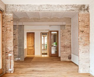A Dramatic Apartment Renovation in Barcelona Features Salvaged Tile and Brick - Photo 3 of 13 -