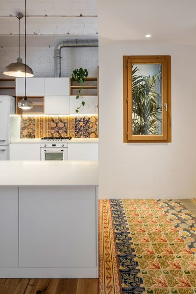 Ceramic Tile Floor  Photo 9 of 14 in A Dramatic Apartment Renovation in Barcelona Features Salvaged Tile and Brick
