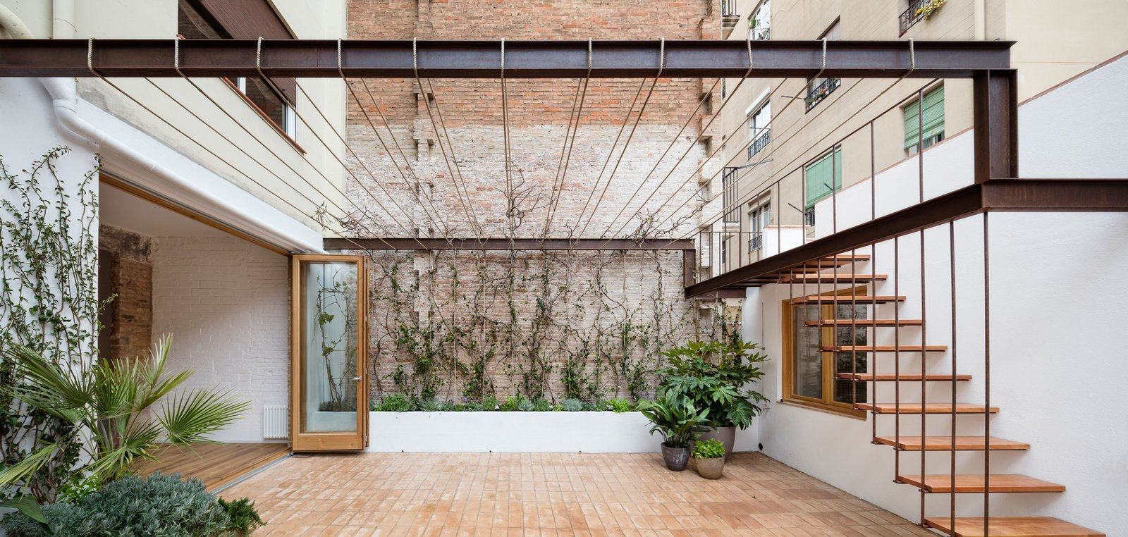 Outdoor and Large Patio, Porch, Deck  Photo 13 of 14 in A Dramatic Apartment Renovation in Barcelona Features Salvaged Tile and Brick