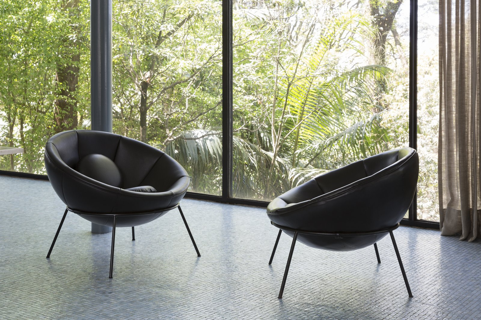 Living Room  Photo 1 of 11 in Modern Master Lina Bo Bardi's Bowl Chair Makes a Comeback