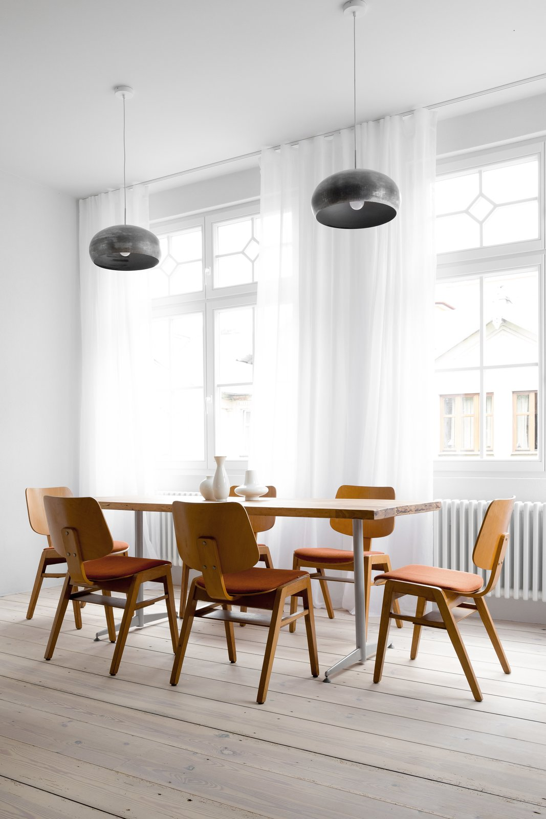 Dining Room, Chair, Table, Pendant Lighting, and Light Hardwood Floor  Best Photos from A Holiday Apartment in Poland With the Perfect Mix of Vintage and Custom Furniture
