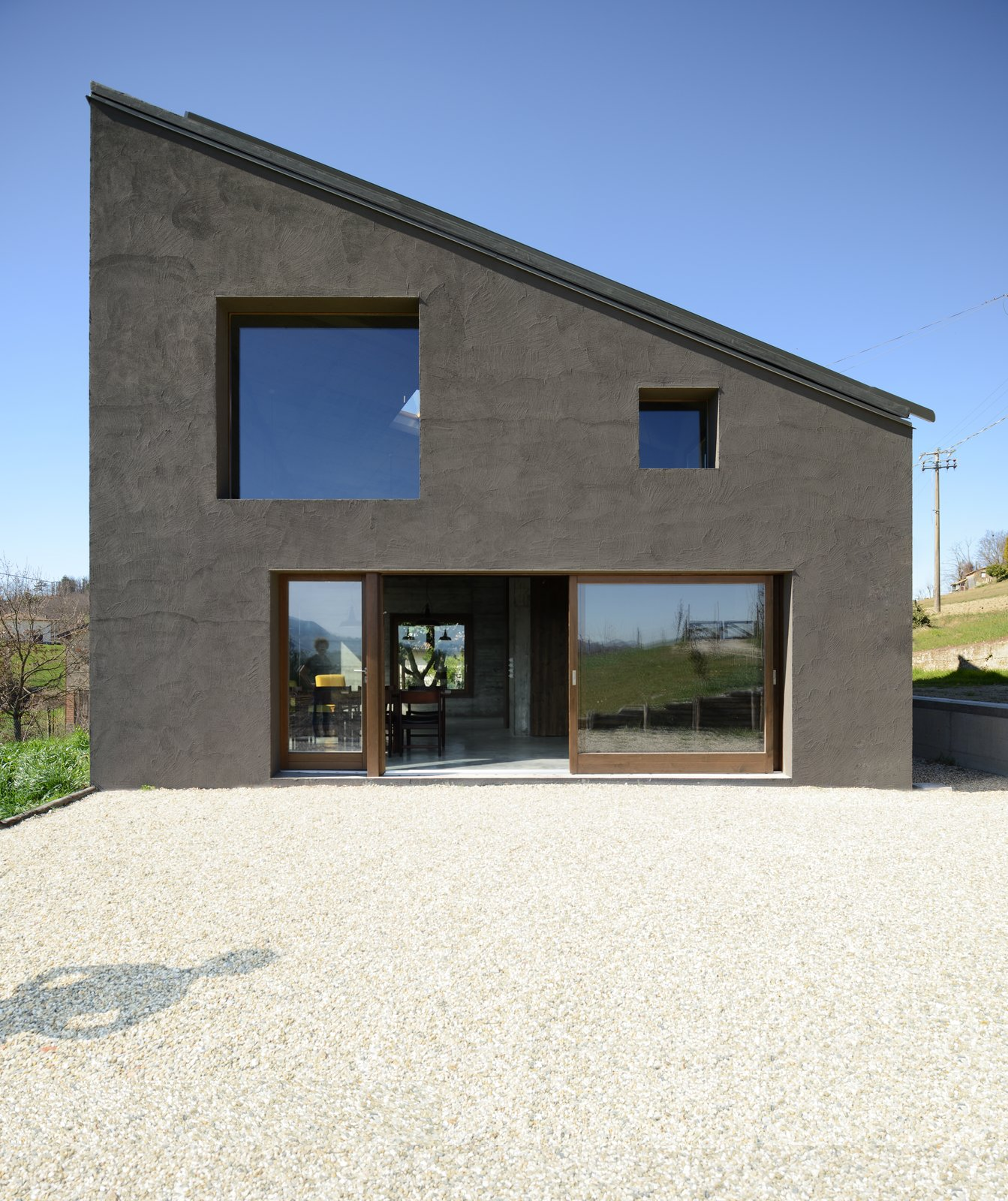 Doors, Exterior, Sliding Door Type, and Wood  Photo 2 of 11 in A Concrete Hideaway in the Italian Countryside