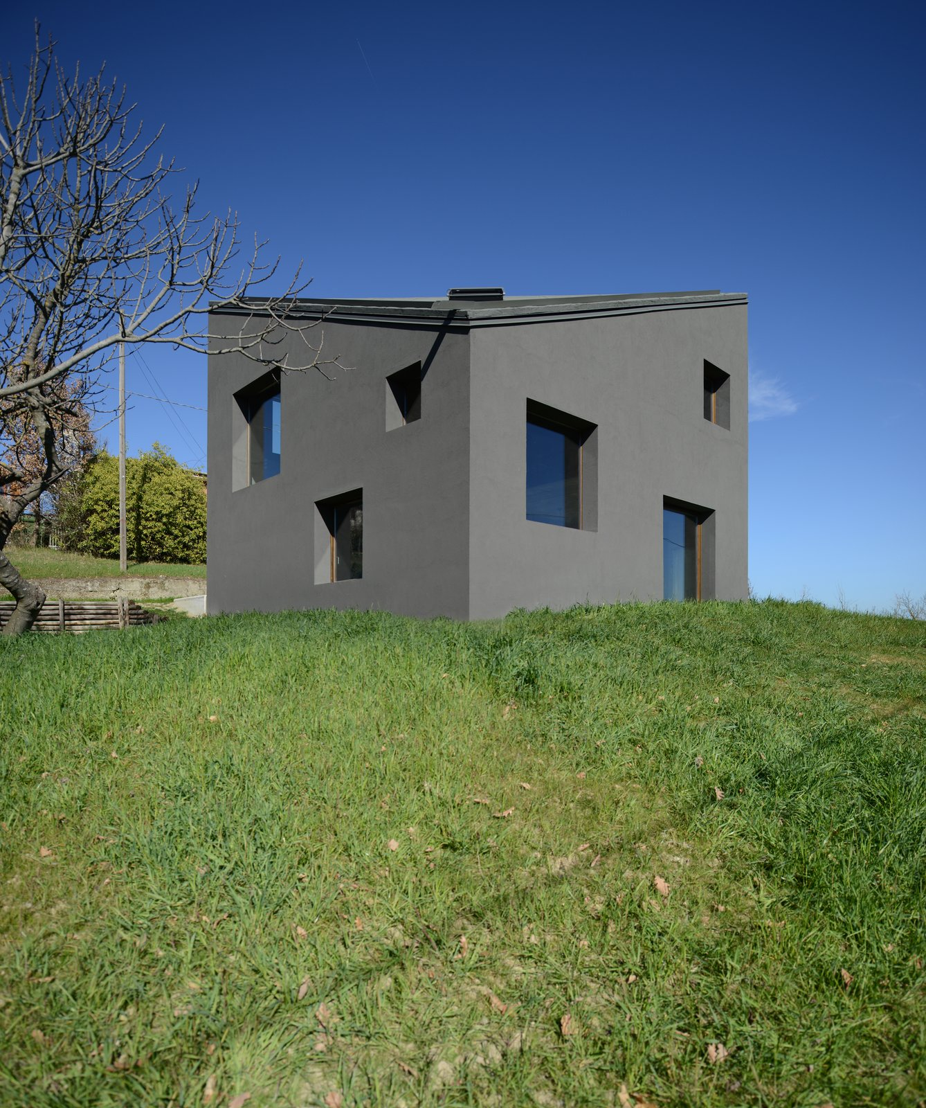 Exterior, House Building Type, and Concrete Siding Material  Photo 1 of 11 in A Concrete Hideaway in the Italian Countryside
