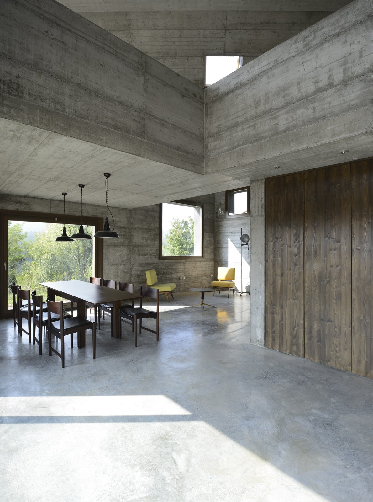 Living Room, Chair, Coffee Tables, Pendant Lighting, and Concrete Floor  Best Photos from A Concrete Hideaway in the Italian Countryside