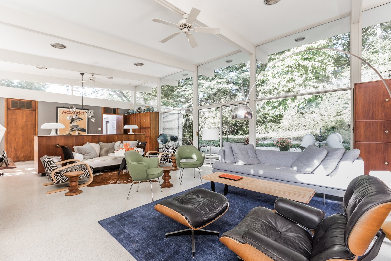 Living Room, Chair, Sofa, End Tables, Coffee Tables, Storage, Ceiling Lighting, Pendant Lighting, Floor Lighting, Recliner, Table Lighting, and Lamps  Photo 3 of 10 in A Midcentury Gem by a Famed Indiana Architect Offered at $450K