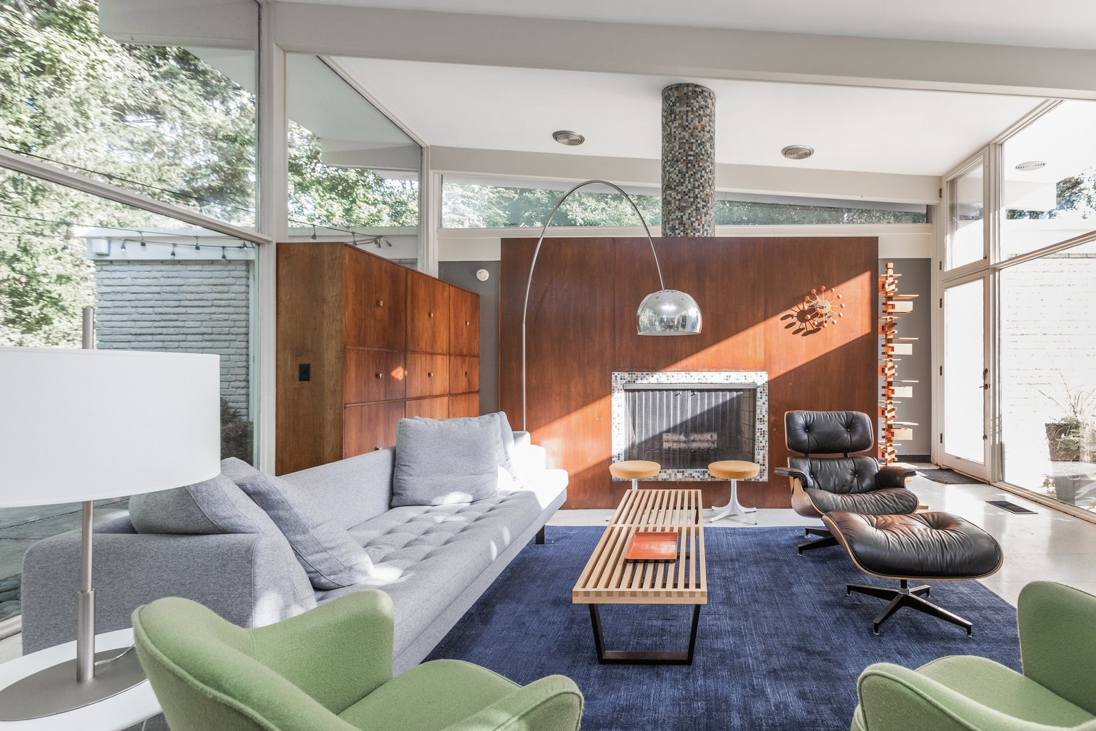 Living Room, Sofa, Chair, Stools, Coffee Tables, End Tables, Lamps, Floor Lighting, Storage, Table Lighting, Wood Burning Fireplace, and Recliner  Photo 5 of 10 in A Midcentury Gem by a Famed Indiana Architect Offered at $450K