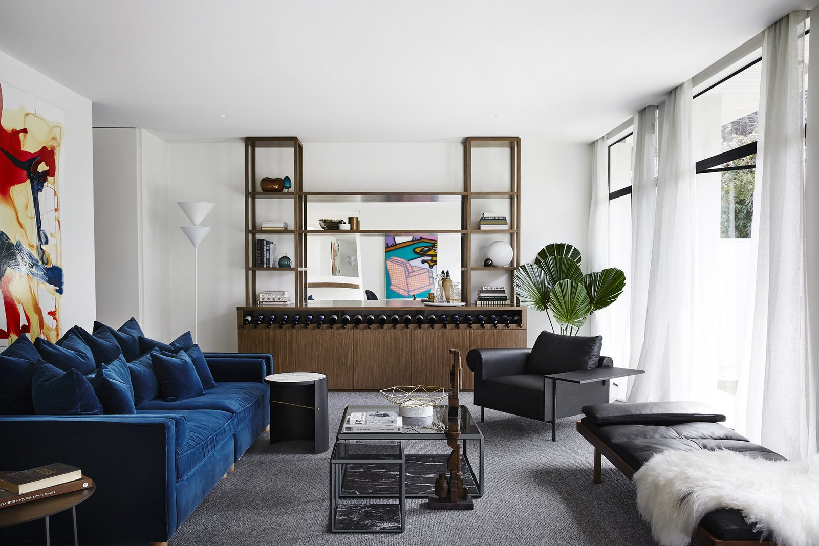 Living Room, Sofa, Floor Lighting, Bookcase, Coffee Tables, Chair, and End Tables  Photo 3 of 13 in A Melbourne Midcentury Gets a Palm Springs-Inspired Revival