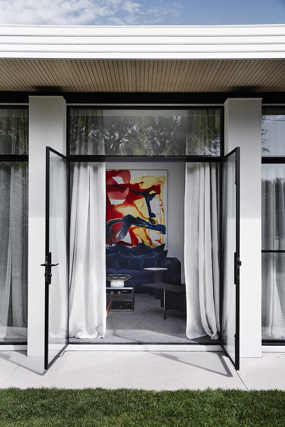 Doors, Metal, Swing Door Type, and Exterior  Photo 8 of 13 in A Melbourne Midcentury Gets a Palm Springs-Inspired Revival