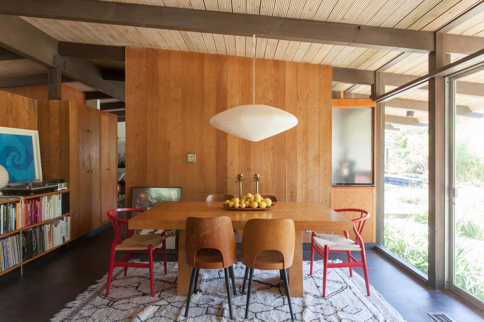 Dining Room, Pendant Lighting, Table, Chair, Rug Floor, and Storage  Photos from Hole Up in This Quintessential Midcentury Modern Rental in Hollywood