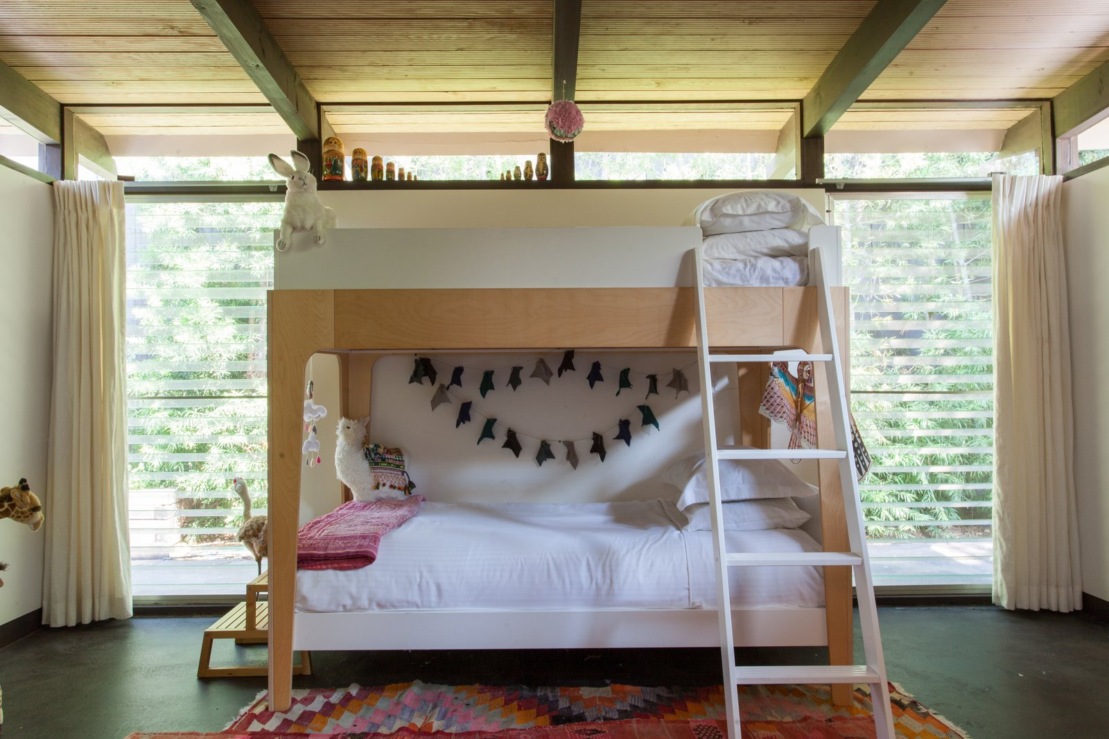 Kids Room, Bunks, Bedroom Room Type, Rug Floor, Pre-Teen Age, and Neutral Gender  Photos from Hole Up in This Quintessential Midcentury Modern Rental in Hollywood