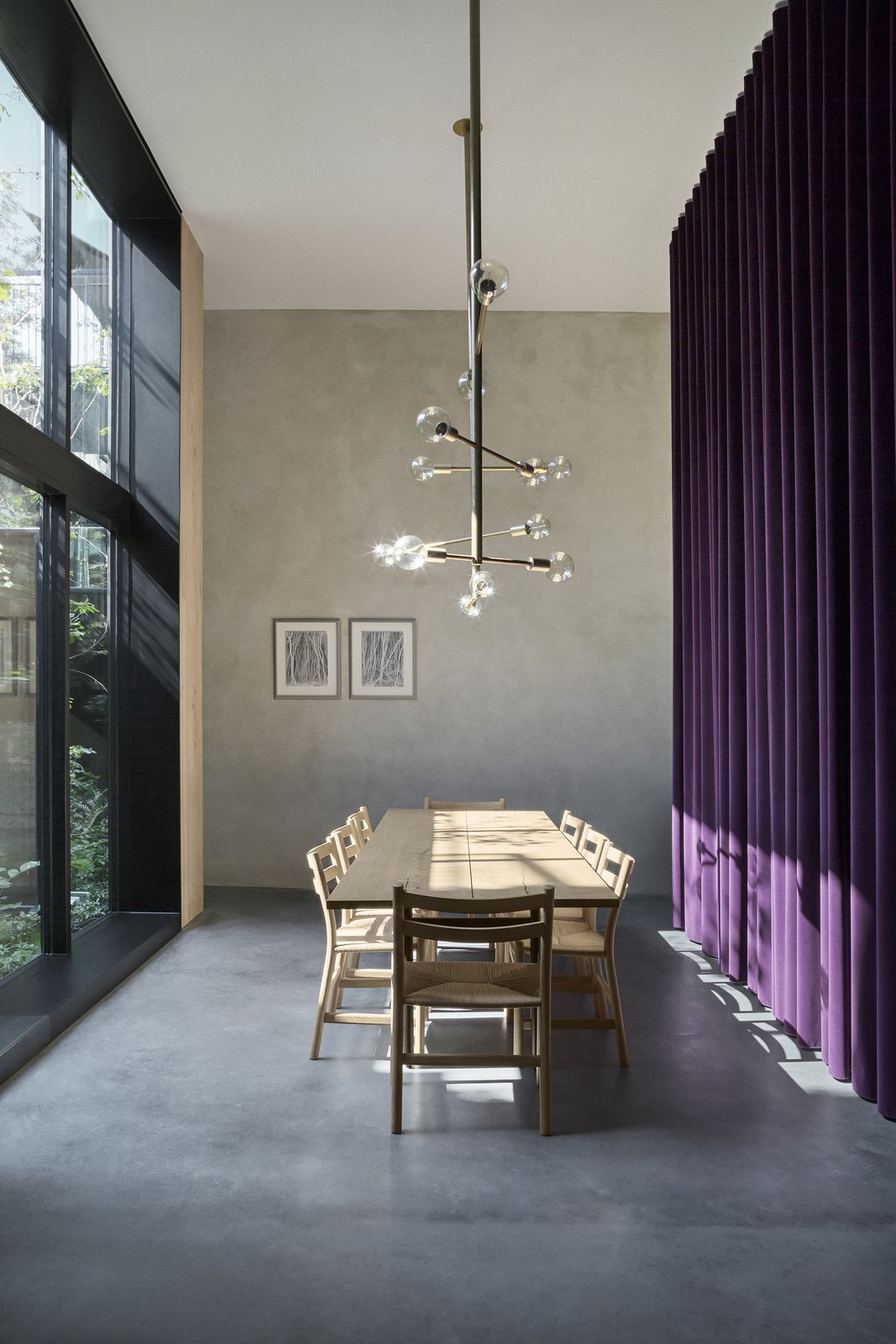 Dining Room, Chair, Table, Pendant Lighting, and Concrete Floor  Best Photos from An Old Factory in Copenhagen Is Now a Photographer's Dream Home