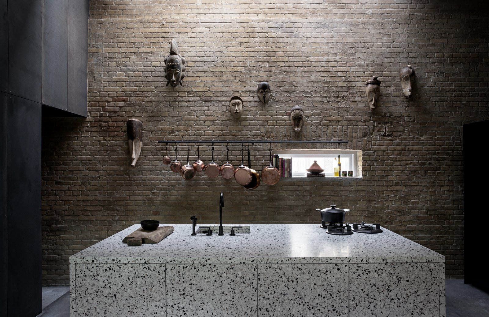 Kitchen, Concrete Floor, Range, and Drop In Sink  Photo 8 of 12 in An Old Factory in Copenhagen Is Now a Photographer's Dream Home