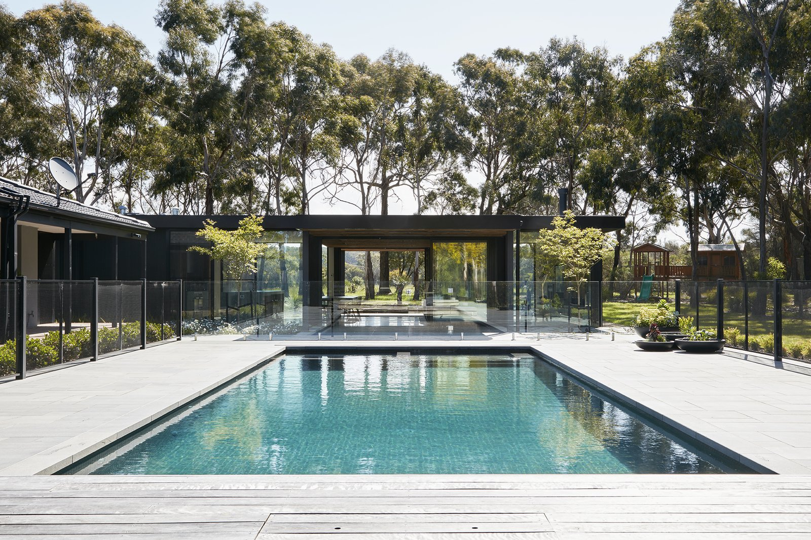 Outdoor, Large Pools, Tubs, Shower, Trees, Concrete Patio, Porch, Deck, Decking Patio, Porch, Deck, Wood Patio, Porch, Deck, and Back Yard  Photo 9 of 9 in Recycled Wood Stars in an Ogle-Worthy Renovation in Australia