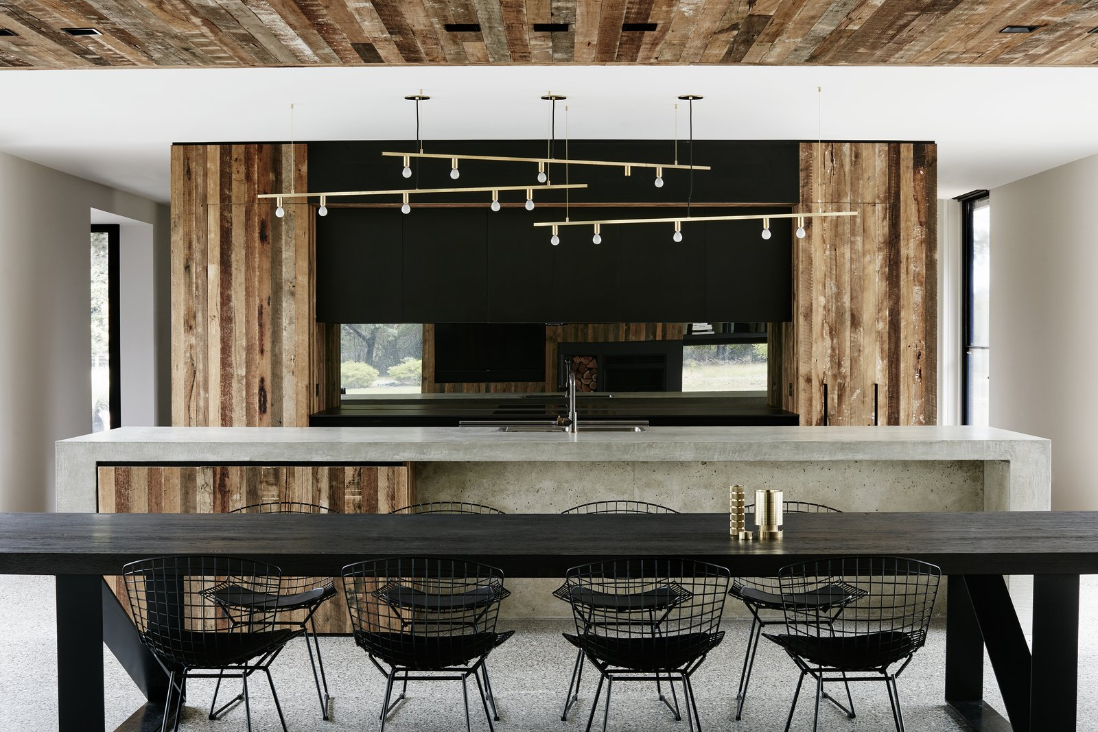 Kitchen, Wood Cabinet, Concrete Counter, Pendant Lighting, and Concrete Floor  Photo 1 of 9 in Recycled Wood Stars in an Ogle-Worthy Renovation in Australia