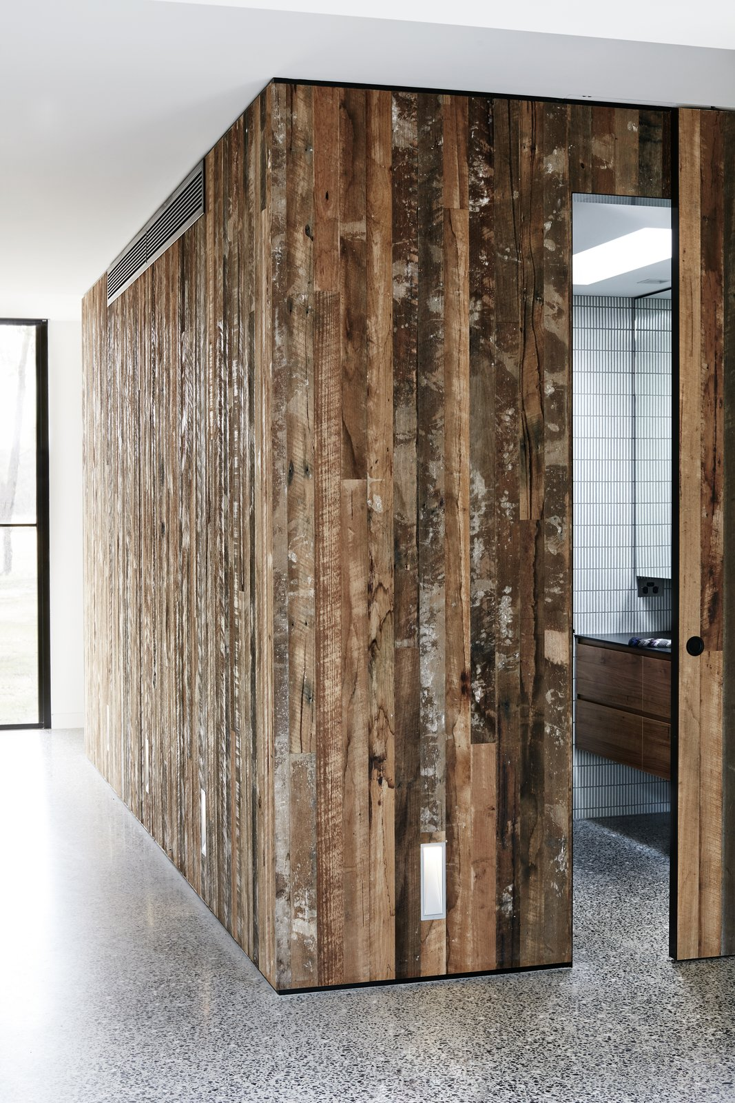 Bath Room, Ceramic Tile Wall, and Concrete Floor  Photo 5 of 9 in Recycled Wood Stars in an Ogle-Worthy Renovation in Australia