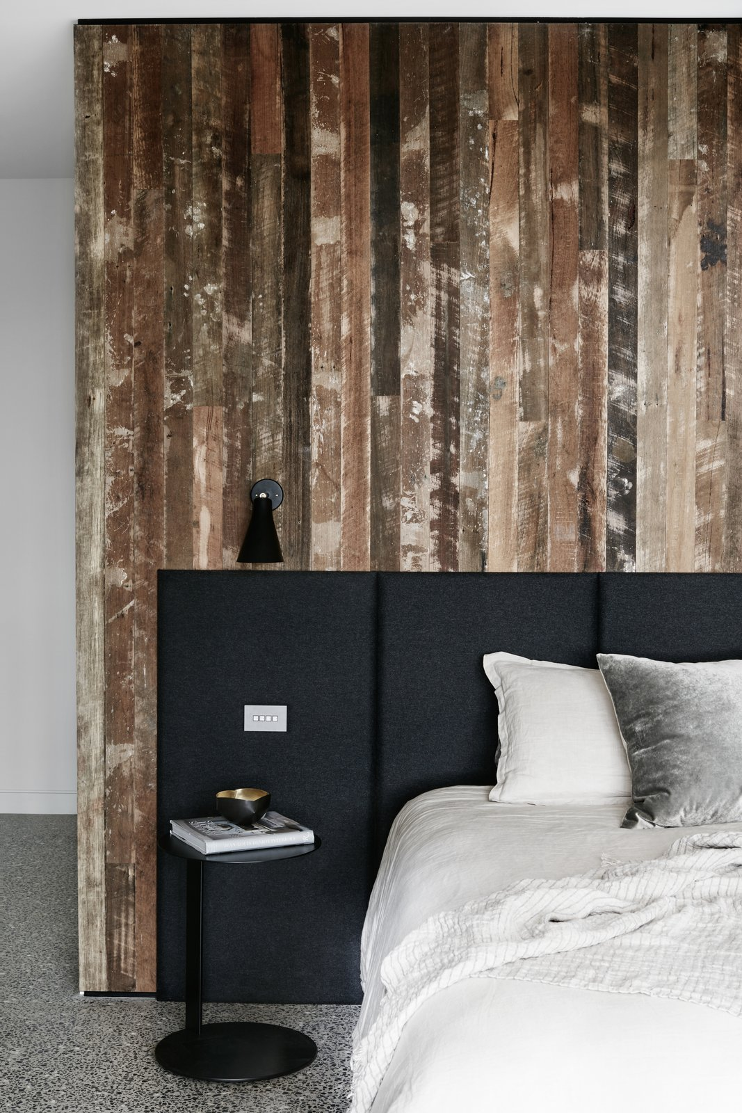 Bedroom, Bed, Wall Lighting, and Concrete Floor  Photo 7 of 9 in Recycled Wood Stars in an Ogle-Worthy Renovation in Australia