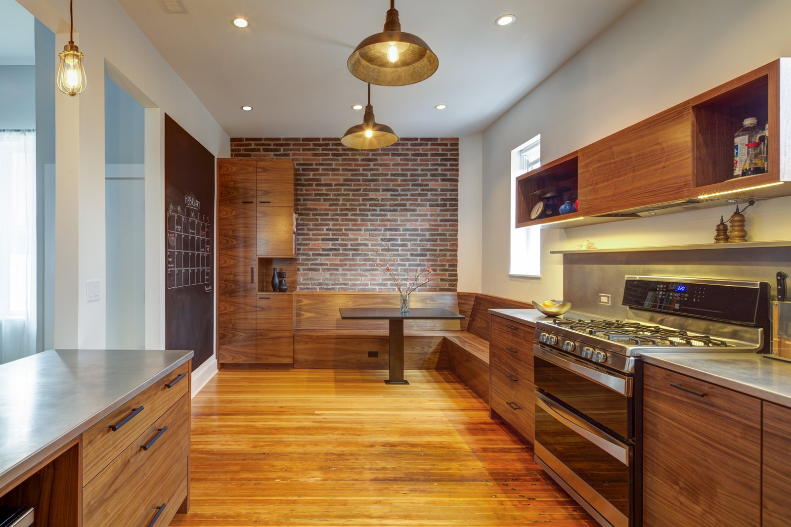 Kitchen, Pendant, Wall Oven, Wood, Range, Metal, Medium Hardwood, Metal, and Recessed  Kitchen Metal Metal Medium Hardwood Photos from What's the Most Overlooked Feature When Planning a Kitchen Renovation?