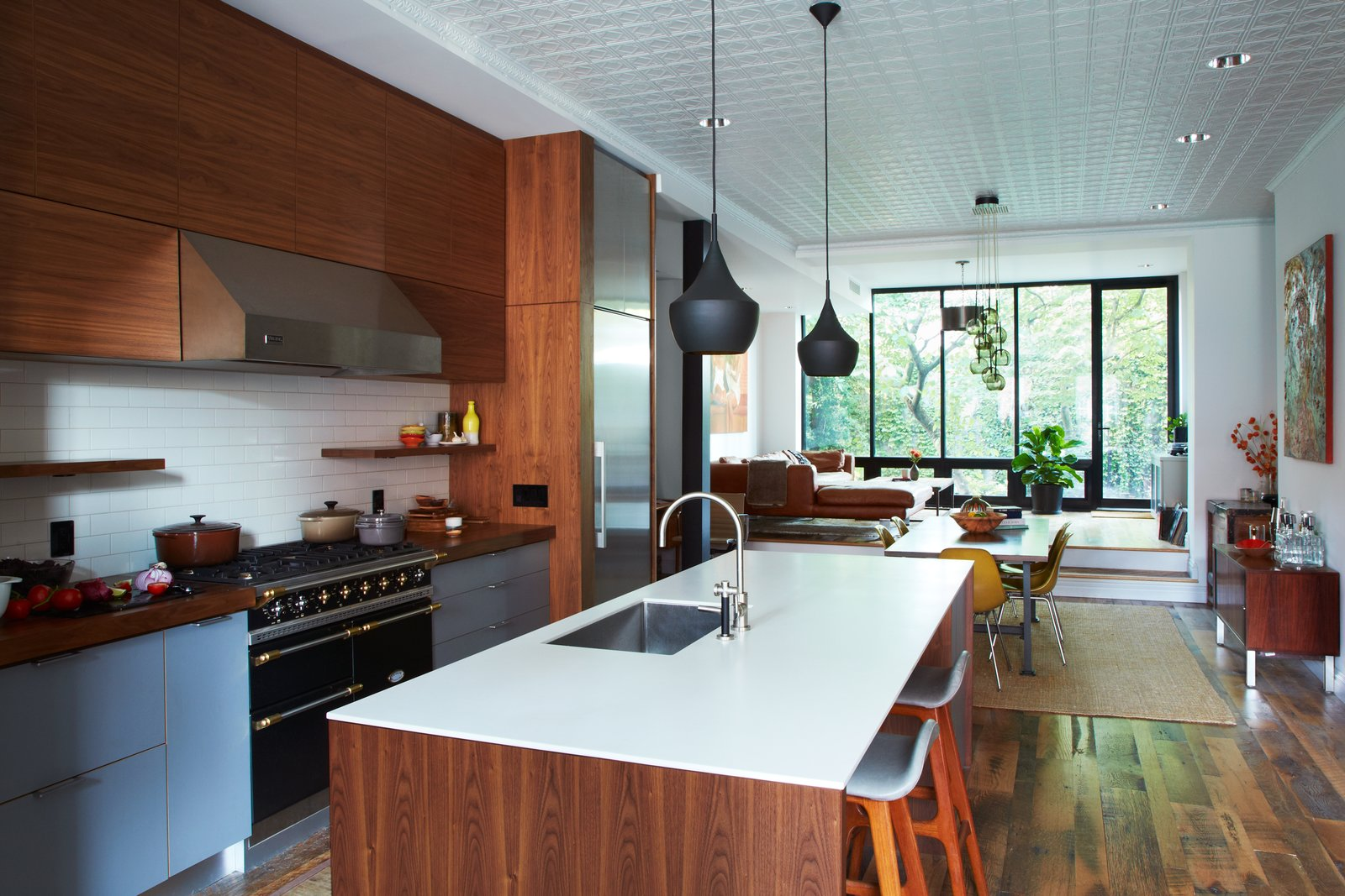 Kitchen, Range, Dark Hardwood, Subway Tile, Wood, Pendant, Recessed, Undermount, Wall Oven, Range Hood, Refrigerator, Wood, and Engineered Quartz  Best Kitchen Wall Oven Wood Undermount Recessed Engineered Quartz Range Photos from What's the Most Overlooked Feature When Planning a Kitchen Renovation?